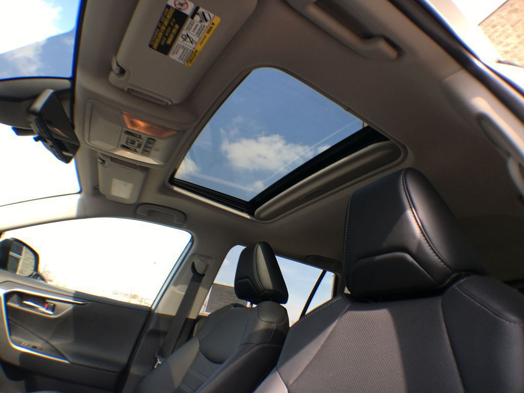 White[Blizzard Pearl] 2021 Toyota RAV4 AWD Limited Package D1RFVT AB Left Front Interior Photo in Brampton ON