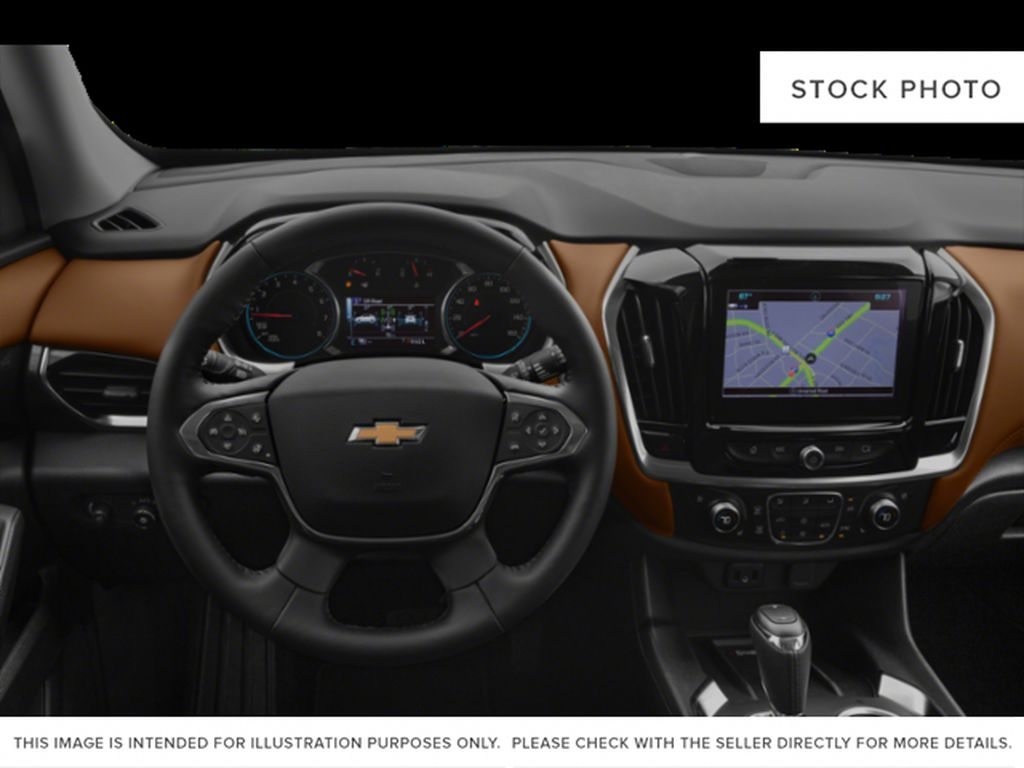 White[Iridescent Pearl Tricoat] 2019 Chevrolet Traverse Steering Wheel and Dash Photo in Fort Macleod AB