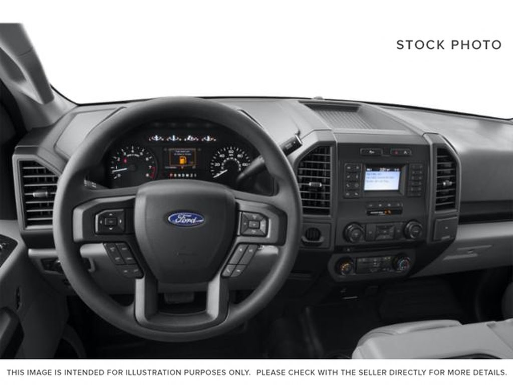 Gray[Abyss Grey] 2019 Ford F-150 Steering Wheel and Dash Photo in Fort Macleod AB