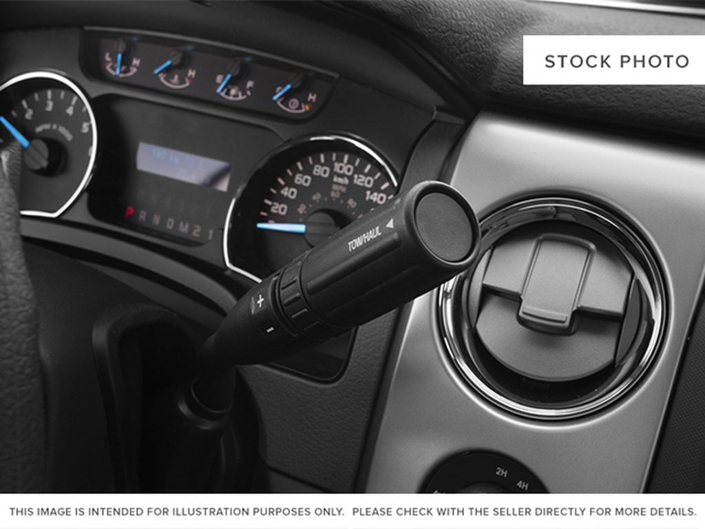 Black[Tuxedo Black Metallic] 2013 Ford F-150 Center Console Photo in Fort Macleod AB