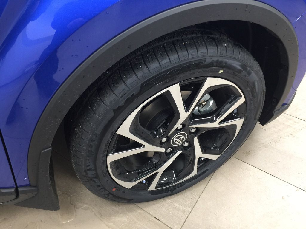 Blue[Blue Eclipse Metallic w/Black Roof] 2021 Toyota C-HR XLE Premium Right Front Rim and Tire Photo in Sherwood Park AB