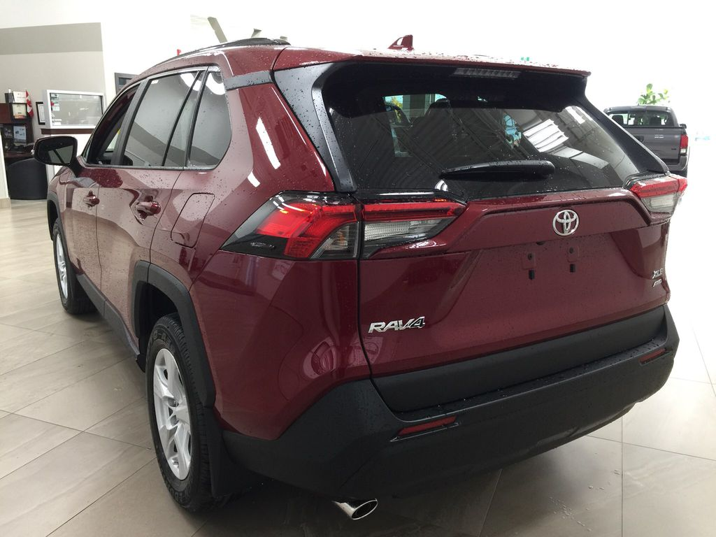 Red[Ruby Flare Pearl] 2021 Toyota RAV4 XLE AWD Left Rear Corner Photo in Sherwood Park AB