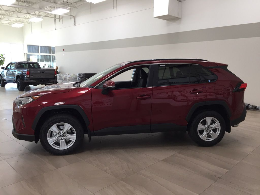 Red[Ruby Flare Pearl] 2021 Toyota RAV4 XLE AWD Left Side Photo in Sherwood Park AB