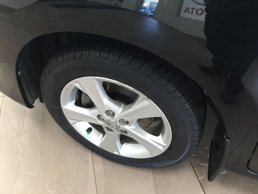 Black[Black Sand Pearl] 2014 Toyota Matrix / AUTOMATIC Left Front Rim and Tire Photo in Sherwood Park AB