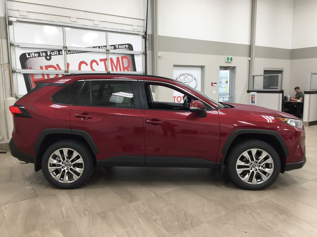 Red[Ruby Flare Pearl] 2021 Toyota RAV4 XLE Premium Right Side Photo in Sherwood Park AB