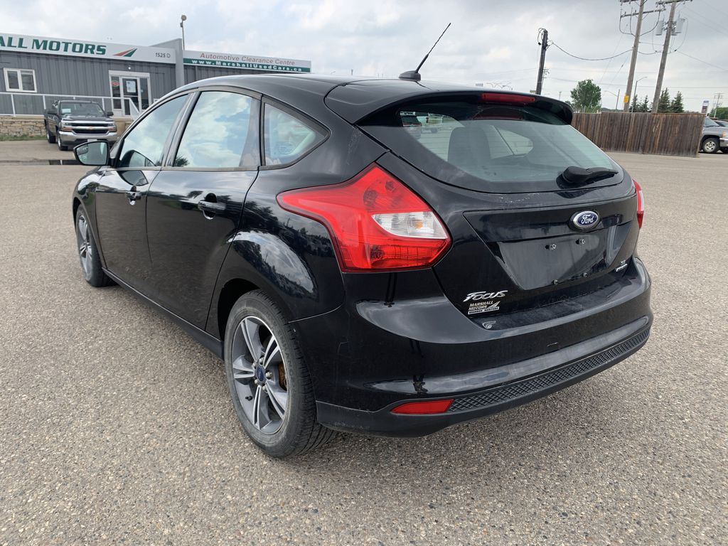 Black 2014 Ford Focus 5dr HB SE *Just Traded!* *Heated Seats* *Bluetooth* Left Rear Corner Photo in Brandon MB