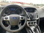 Black 2014 Ford Focus 5dr HB SE *Just Traded!* *Heated Seats* *Bluetooth* Steering Wheel and Dash Photo in Brandon MB