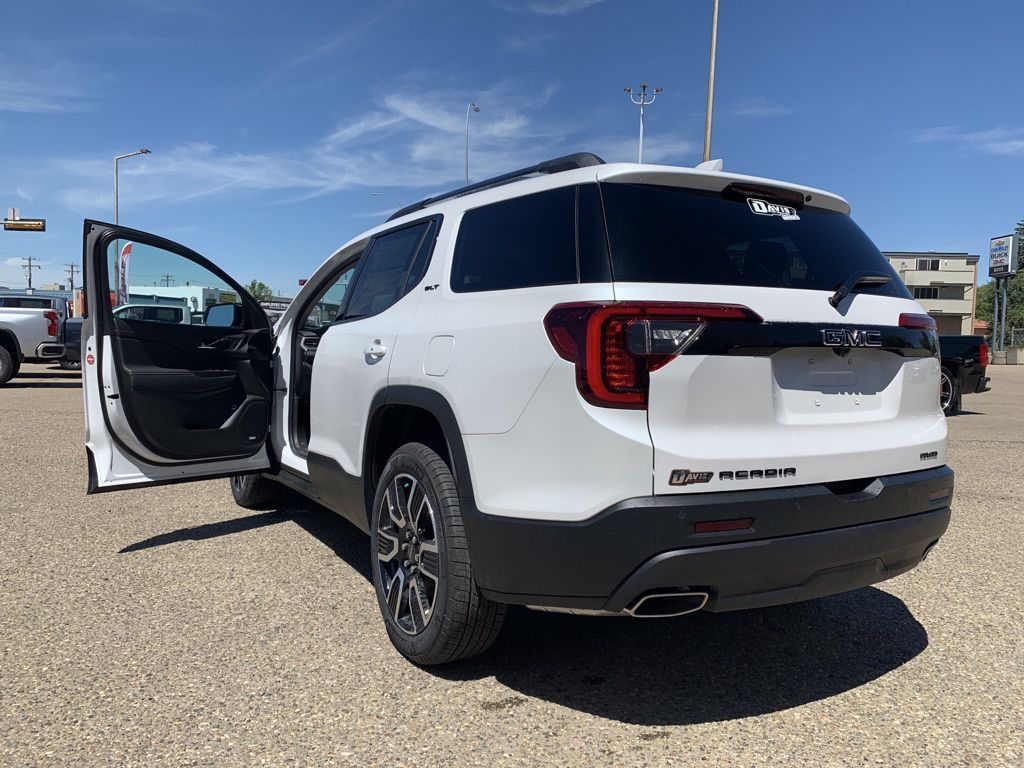 White 2021 GMC Acadia Left Front Rim and Tire Photo in Brooks AB