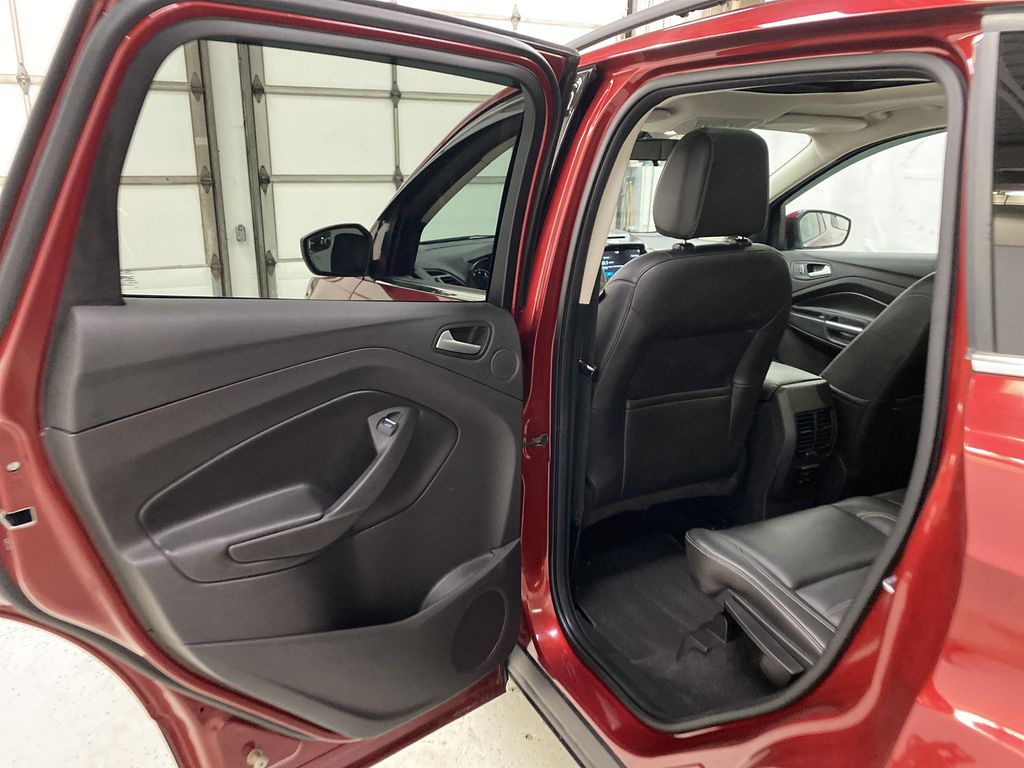 Red[Ruby Red Metallic Tinted Clearcoat] 2017 Ford Escape Left Rear Interior Door Panel Photo in Dartmouth NS