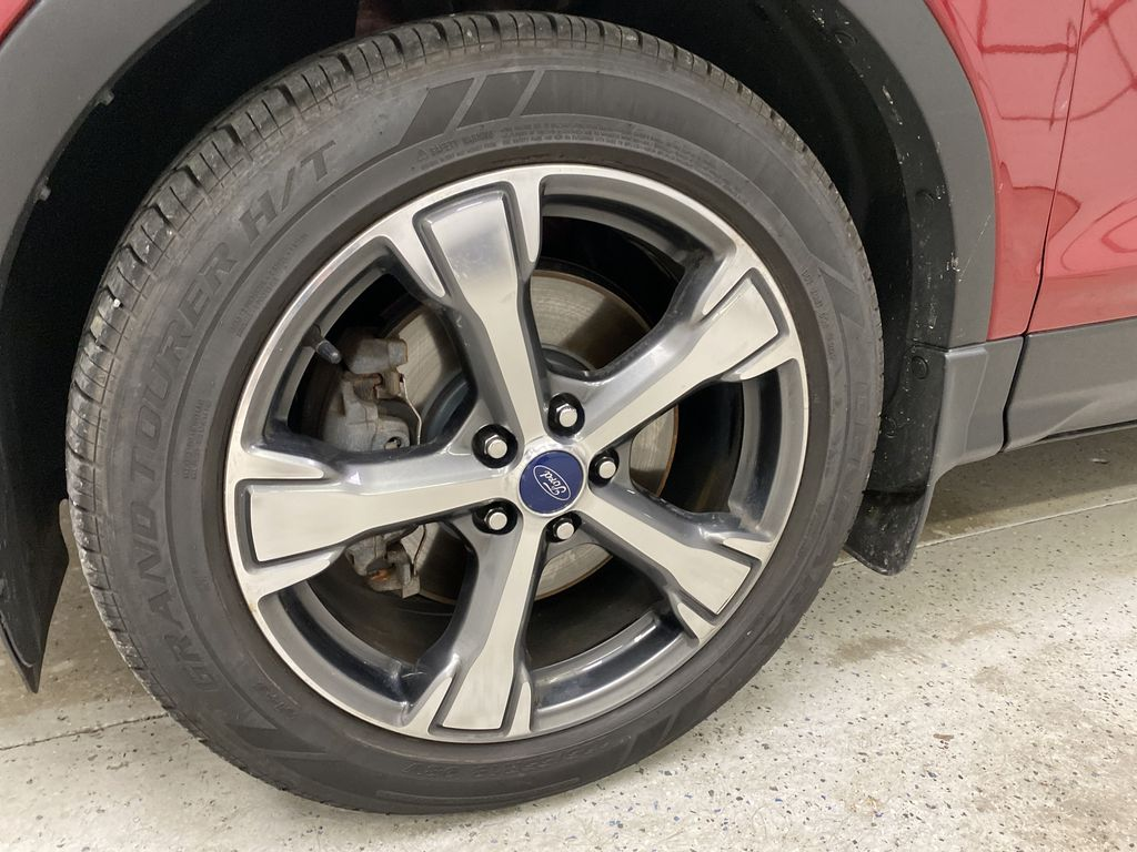Red[Ruby Red Metallic Tinted Clearcoat] 2017 Ford Escape Left Front Rim and Tire Photo in Dartmouth NS