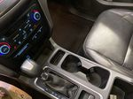 Red[Ruby Red Metallic Tinted Clearcoat] 2017 Ford Escape Center Console Photo in Dartmouth NS
