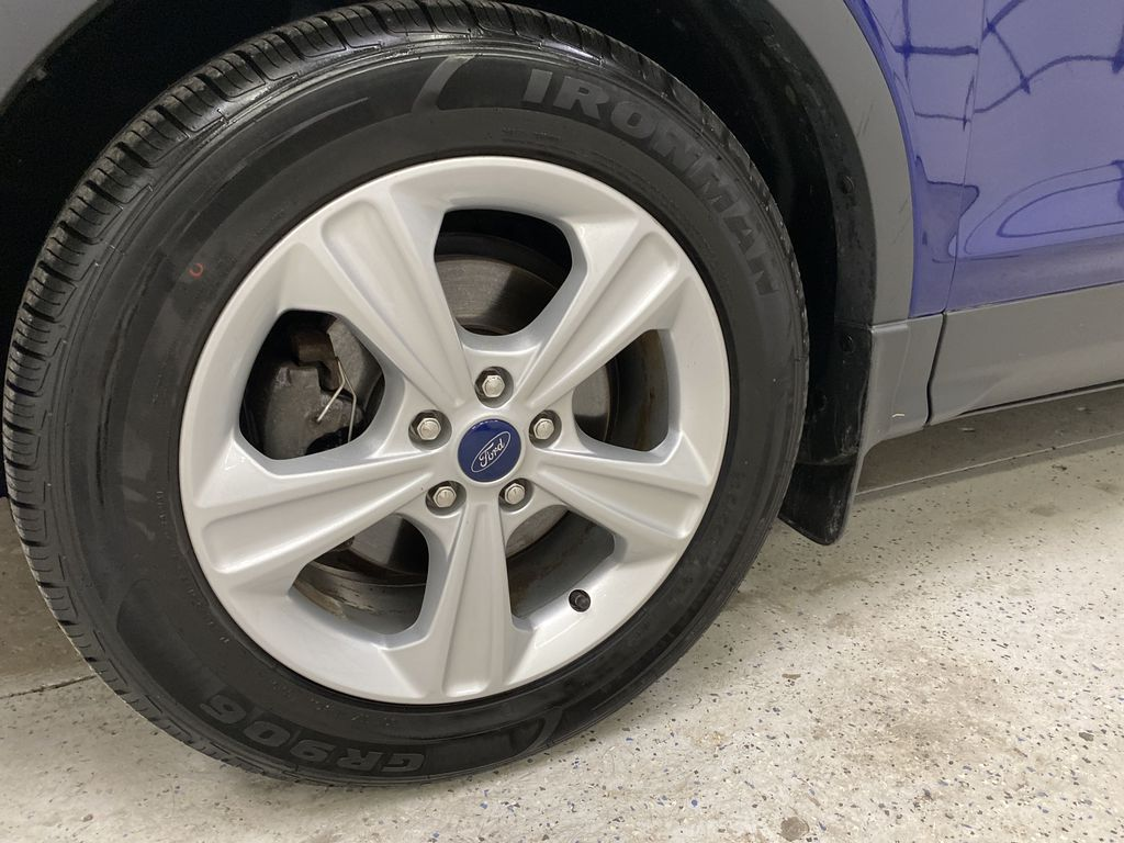 Blue[Deep Impact Blue Metallic] 2016 Ford Escape Left Front Rim and Tire Photo in Dartmouth NS