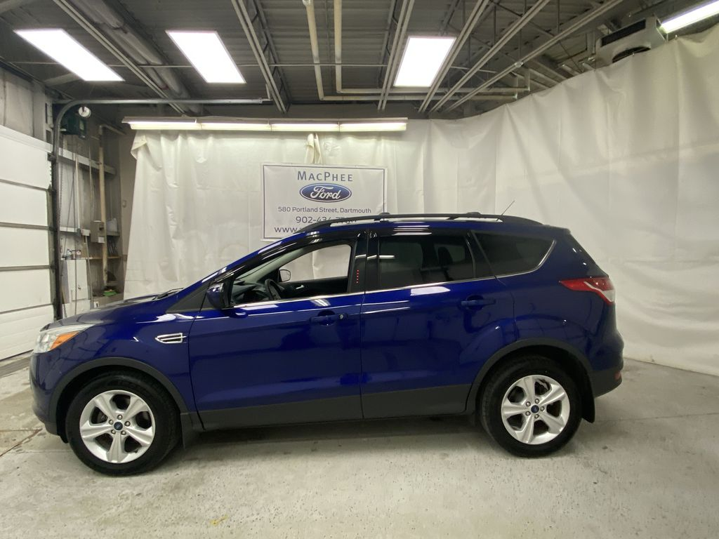 Blue[Deep Impact Blue Metallic] 2016 Ford Escape Left Side Photo in Dartmouth NS