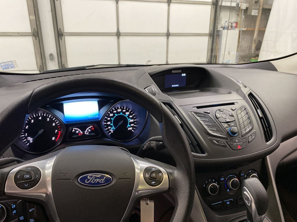 Blue[Deep Impact Blue Metallic] 2016 Ford Escape Steering Wheel and Dash Photo in Dartmouth NS