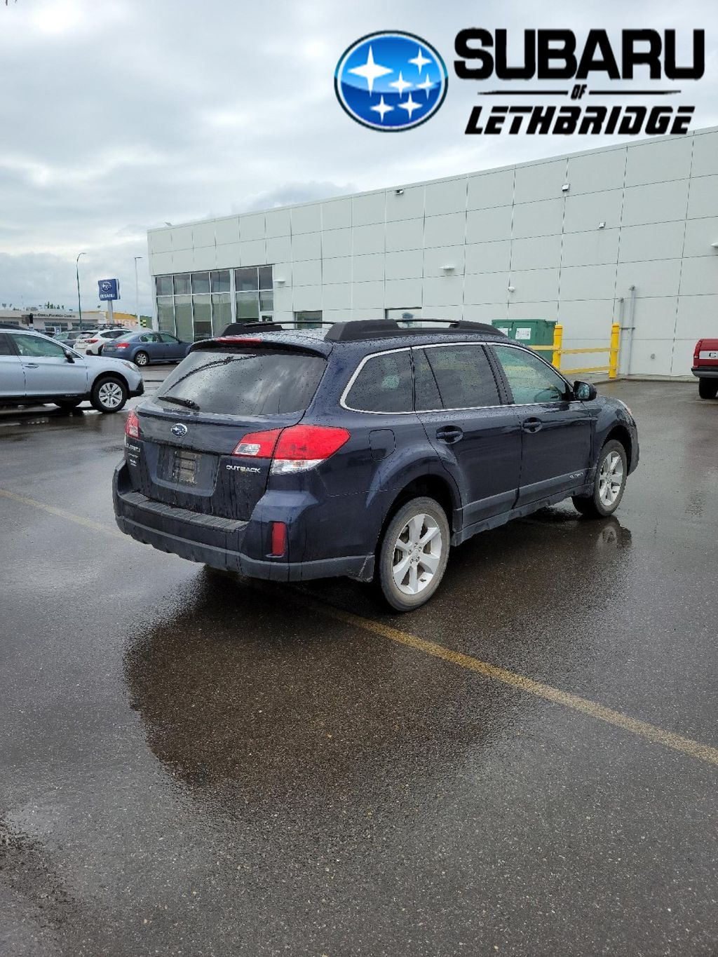 Blue 2013 Subaru Outback Left Front Rim and Tire Photo in Lethbridge AB