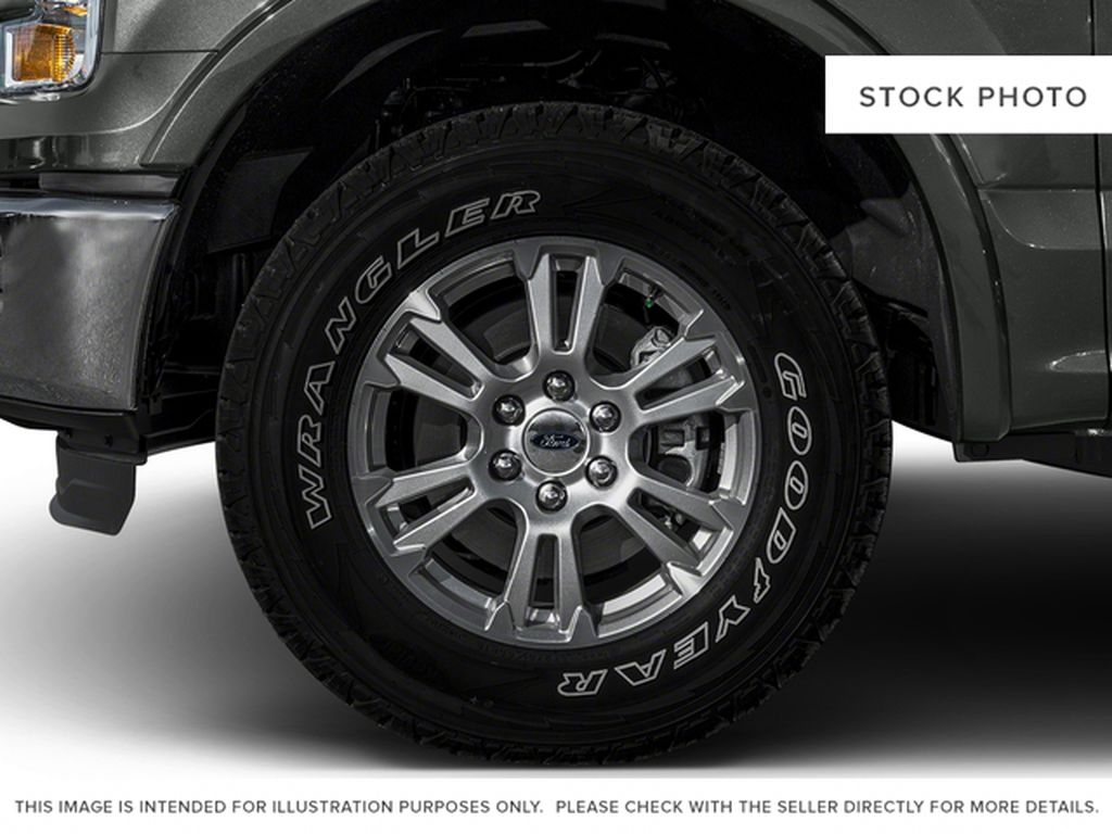 Burgundy 2016 Ford F-150 Left Front Rim and Tire Photo in Fort Macleod AB