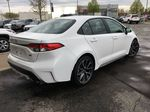 White[Blizzard Pearl w/Black Roof] 2021 Toyota Corolla SE Upgrade Package B4RBSC BM Rear of Vehicle Photo in Brampton ON