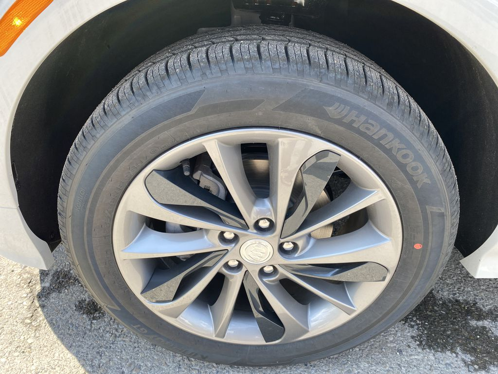 White[Summit White] 2021 Buick Encore GX Left Front Rim and Tire Photo in Canmore AB