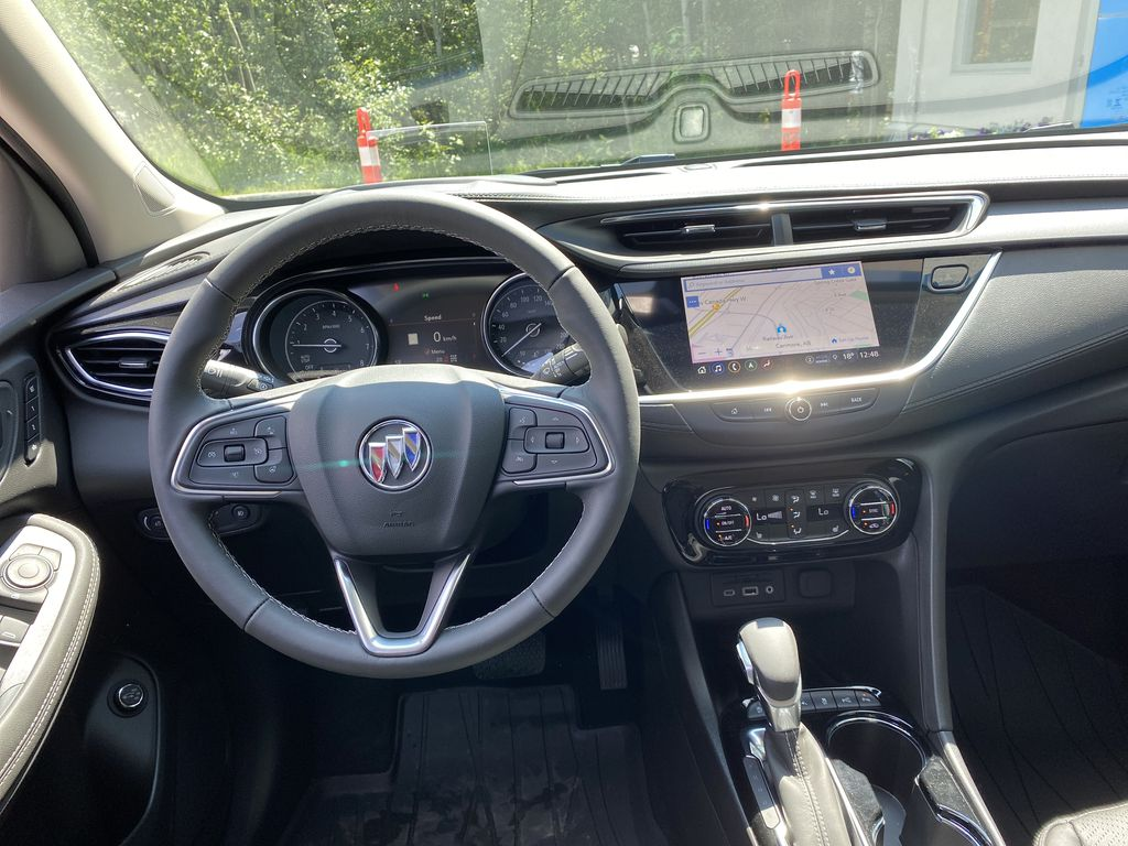 White[Summit White] 2021 Buick Encore GX Strng Wheel/Dash Photo: Frm Rear in Canmore AB