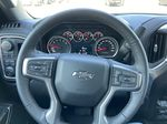White[Iridescent Pearl Tricoat] 2021 Chevrolet Silverado 1500 RST Steering Wheel and Dash Photo in Calgary AB