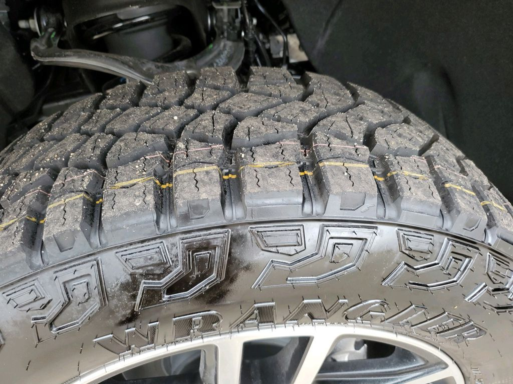 Black 2021 GMC Sierra 1500 Left Front Rim and Tire Photo in Barrhead AB