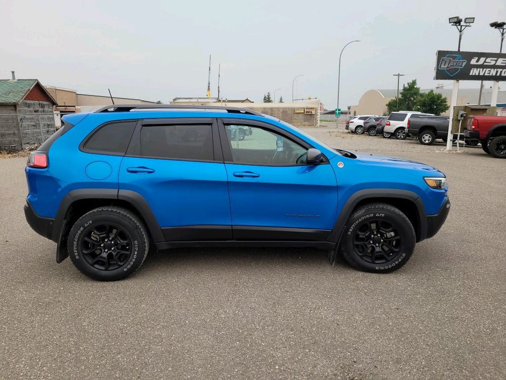 Blue 2019 Jeep Cherokee Left Front Interior Photo in Fort Macleod AB