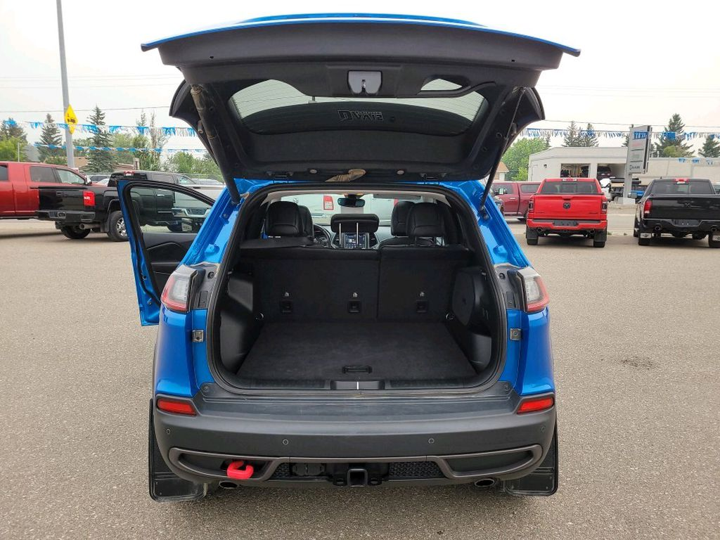 Blue 2019 Jeep Cherokee Left Side Rear Seat  Photo in Fort Macleod AB