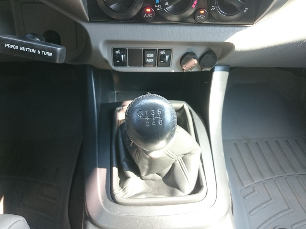 Green[Spruce Mica] 2013 Toyota Tacoma Center Console Photo in Kelowna BC