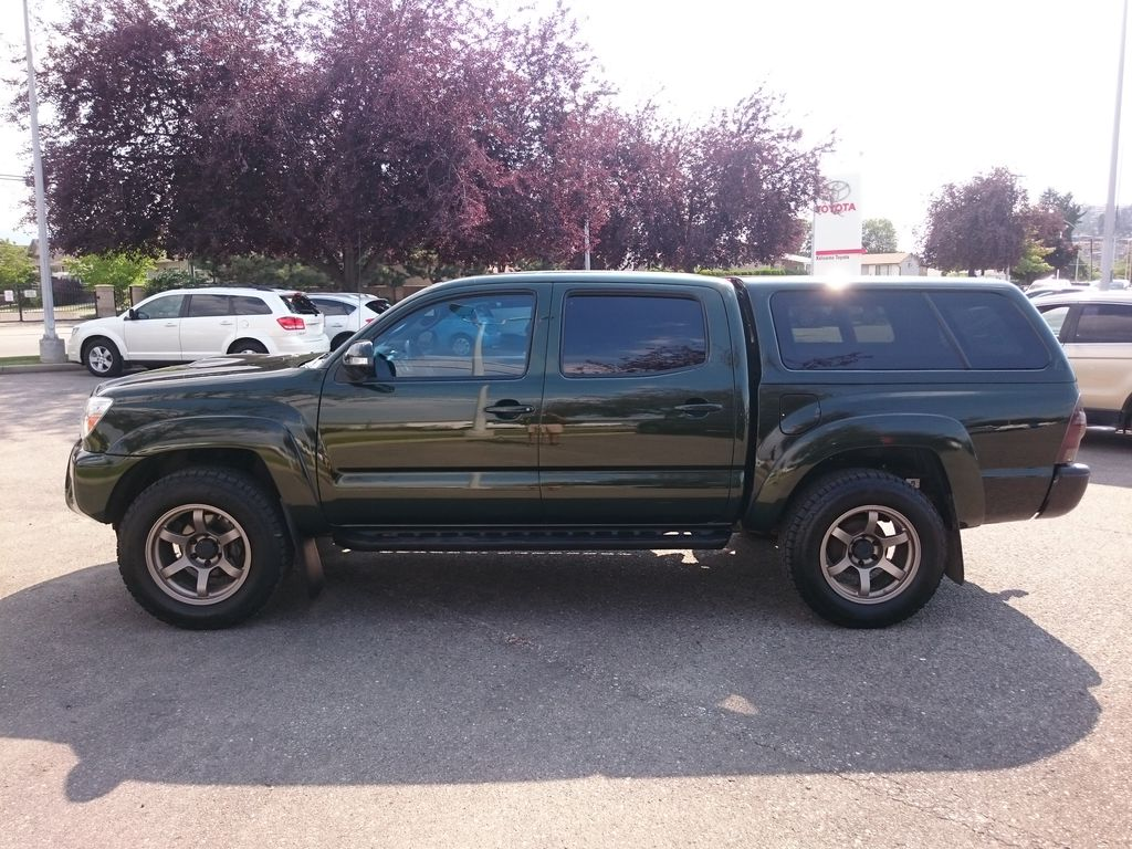 Green[Spruce Mica] 2013 Toyota Tacoma Left Side Photo in Kelowna BC