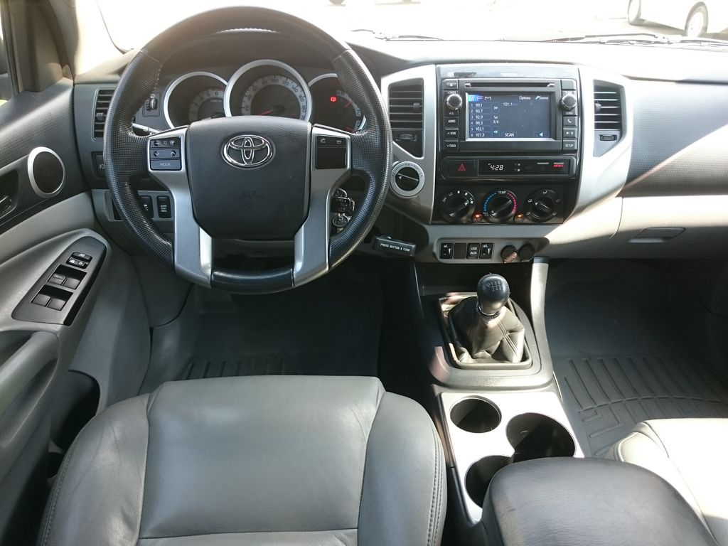 Green[Spruce Mica] 2013 Toyota Tacoma Steering Wheel and Dash Photo in Kelowna BC