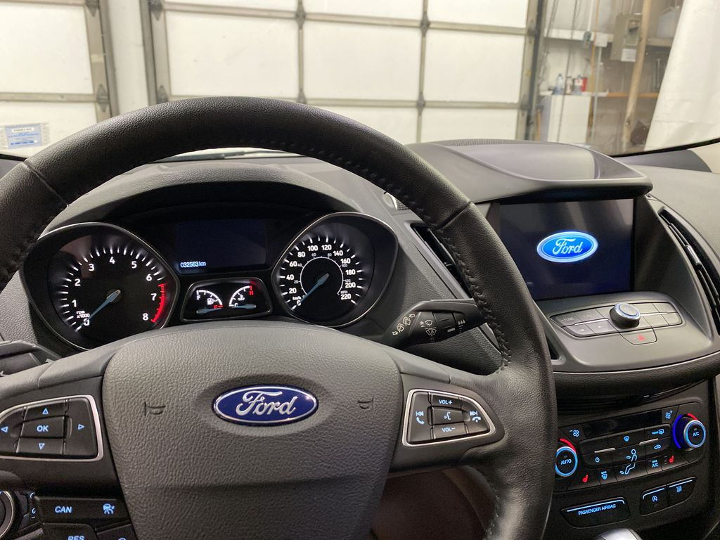 Red[Ruby Red Metallic Tinted Clearcoat] 2019 Ford Escape Steering Wheel and Dash Photo in Dartmouth NS
