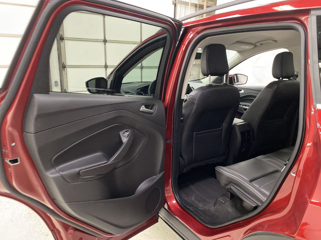 Red[Ruby Red Metallic Tinted Clearcoat] 2019 Ford Escape Left Rear Interior Door Panel Photo in Dartmouth NS