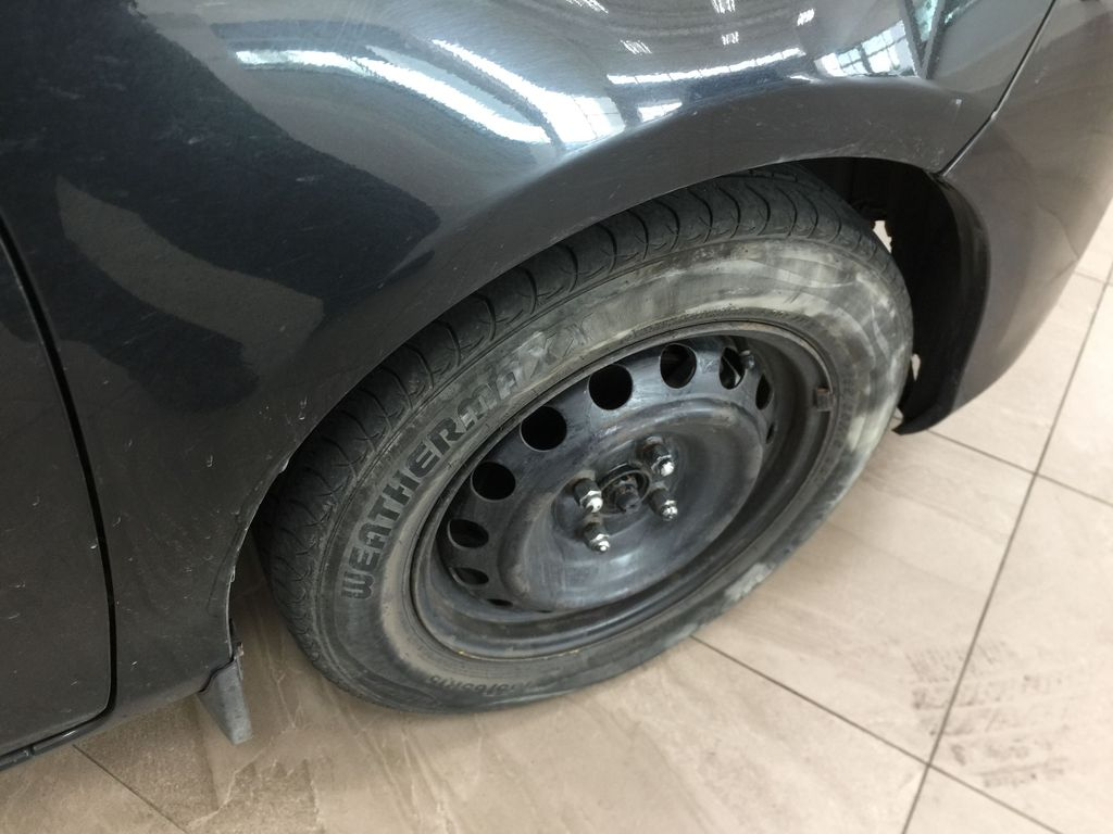 Black[Black Sand Pearl] 2015 Toyota Yaris / MANUAL TRANMISSION Right Front Rim and Tire Photo in Sherwood Park AB