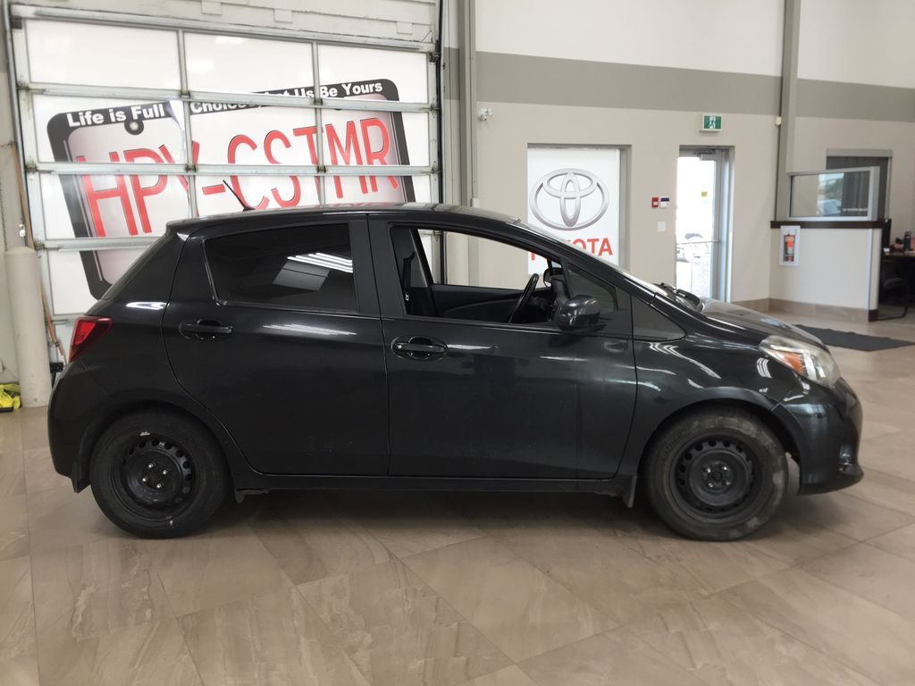 Black[Black Sand Pearl] 2015 Toyota Yaris / MANUAL TRANMISSION Right Side Photo in Sherwood Park AB