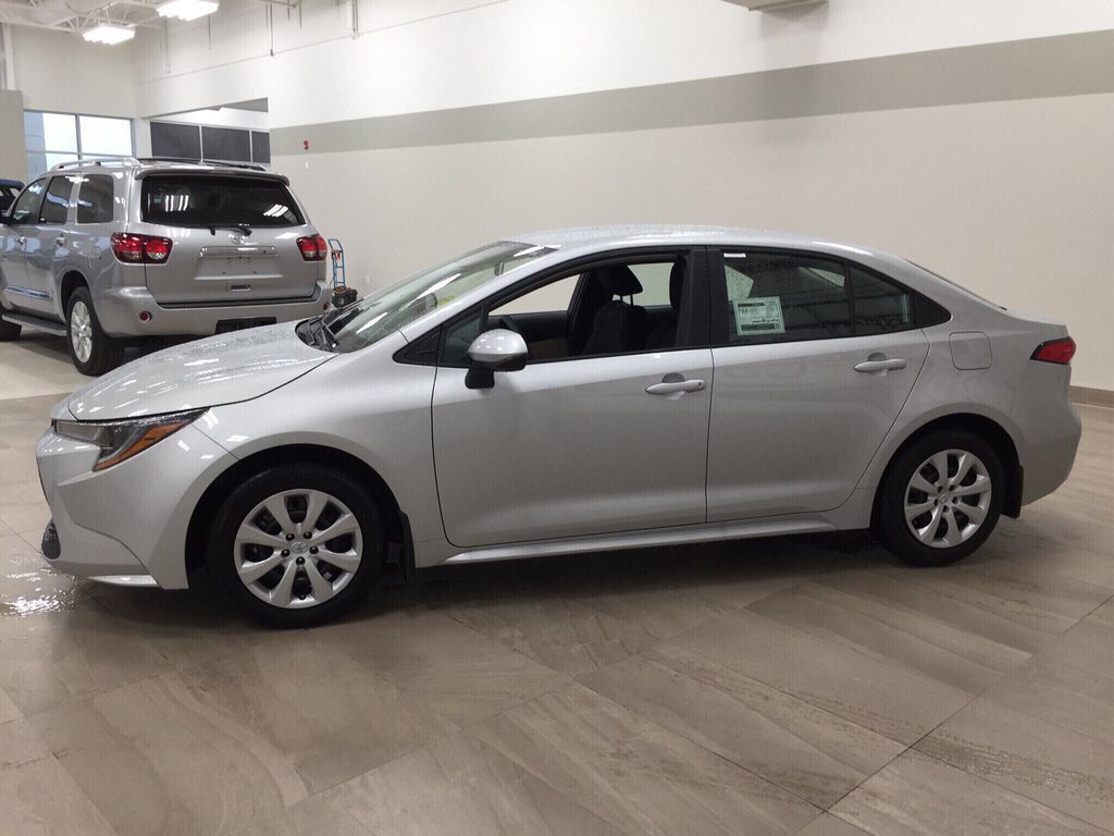 Silver[Classic Silver Metallic] 2021 Toyota Corolla LE Left Side Photo in Sherwood Park AB