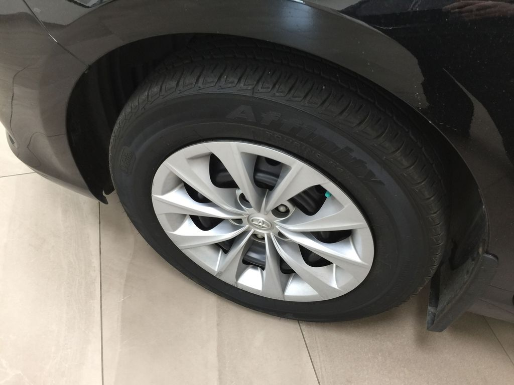 Black[Attitude Black Metallic] 2017 Toyota Camry LE / LOW KMS Left Front Rim and Tire Photo in Sherwood Park AB