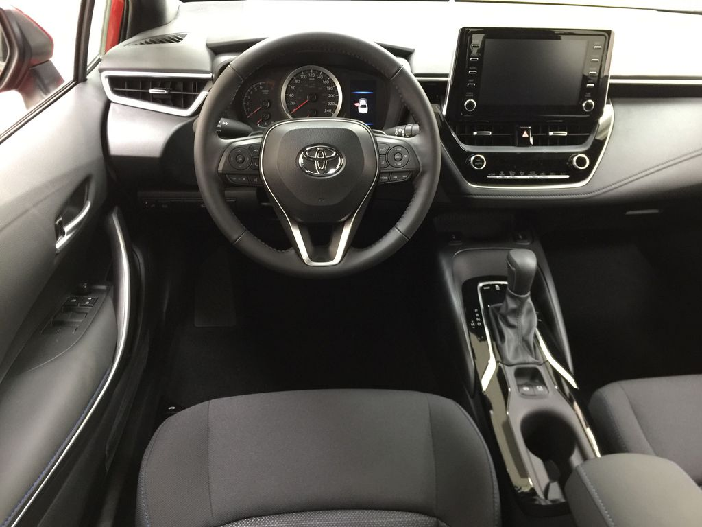 Red[Barcelona Red Metallic] 2021 Toyota Corolla SE Left Front Seat Photo in Sherwood Park AB