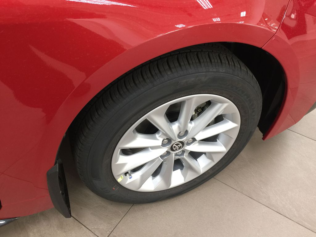 Red[Barcelona Red Metallic] 2021 Toyota Corolla SE Right Front Rim and Tire Photo in Sherwood Park AB
