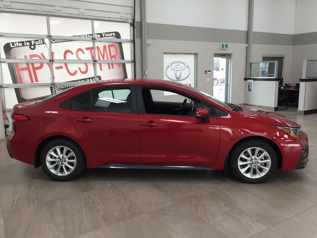 Red[Barcelona Red Metallic] 2021 Toyota Corolla SE Right Side Photo in Sherwood Park AB