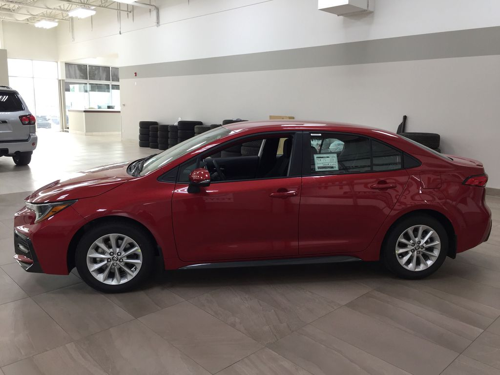Red[Barcelona Red Metallic] 2021 Toyota Corolla SE Left Side Photo in Sherwood Park AB