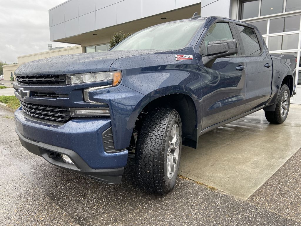 Blue[Northsky Blue Metallic] 2021 Chevrolet Silverado 1500 RST Left Front Head Light / Bumper and Grill in Calgary AB