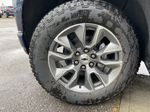 Blue[Northsky Blue Metallic] 2021 Chevrolet Silverado 1500 RST Left Front Rim and Tire Photo in Calgary AB