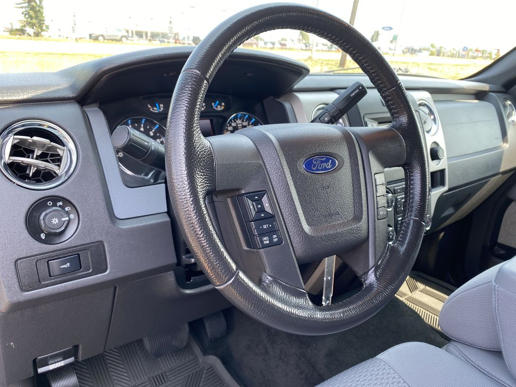 Gray[Sterling Grey Metallic] 2013 Ford F-150 Steering Wheel and Dash Photo in Edmonton AB