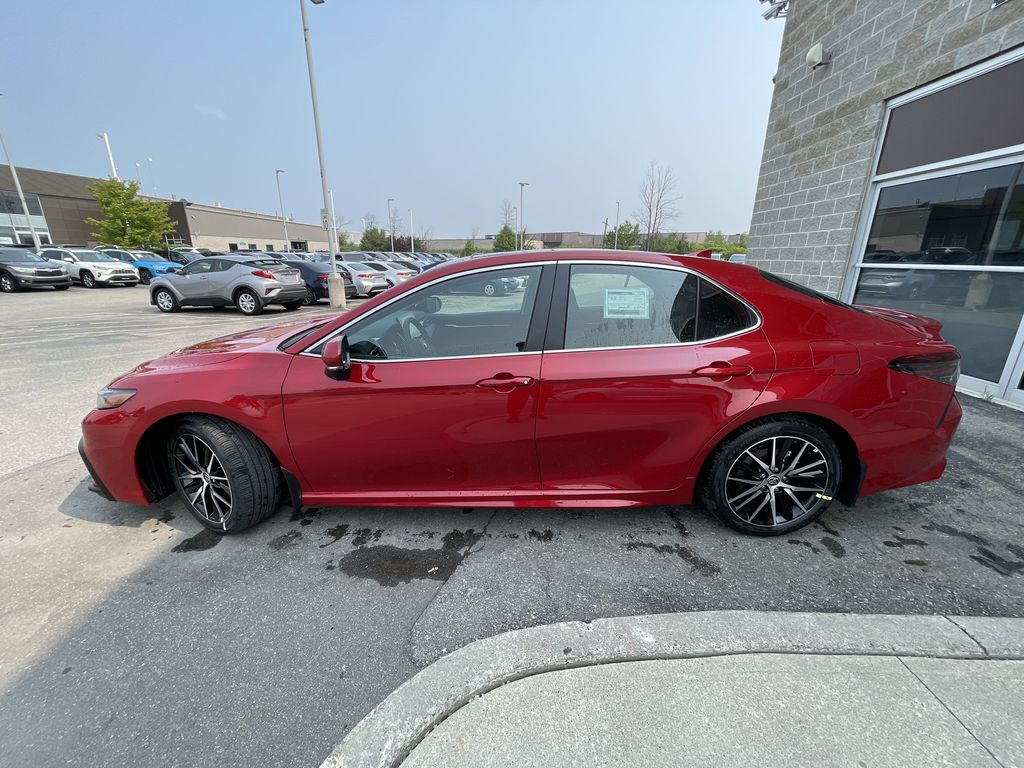 Red[Supersonic Red] 2021 Toyota Camry AWD SE UPGRADE G11BKT BD Left Front Rim and Tire Photo in Brampton ON