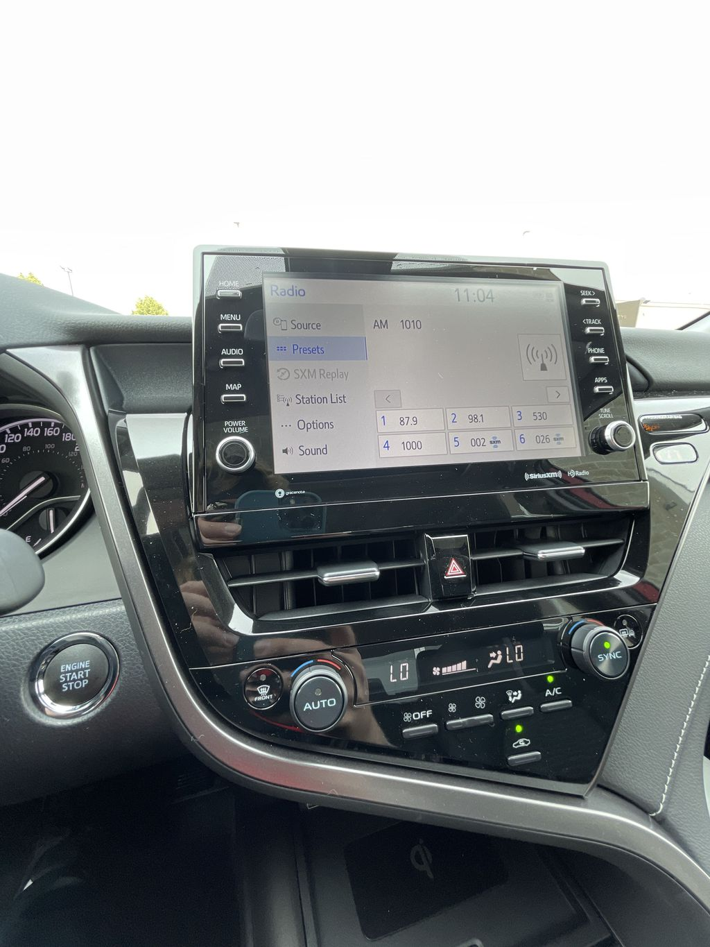 Red[Supersonic Red] 2021 Toyota Camry AWD SE UPGRADE G11BKT BD Strng Wheel/Dash Photo: Frm Rear in Brampton ON