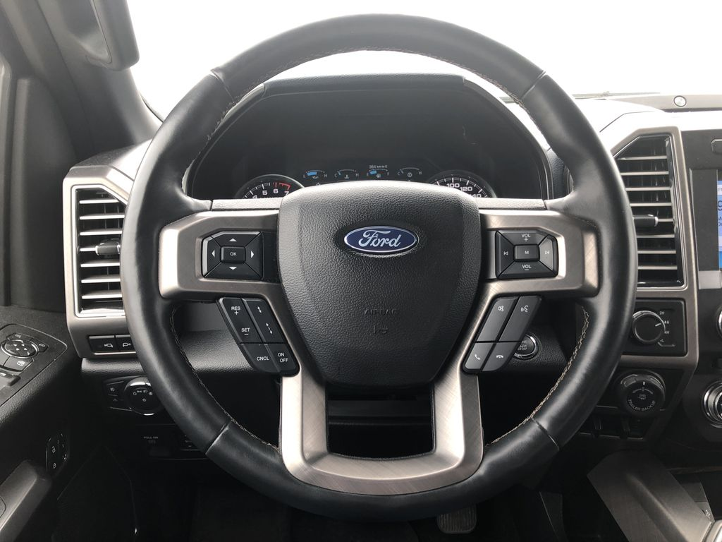 Blue[Blue Jeans Metallic] 2018 Ford F-150 Steering Wheel and Dash Photo in Edmonton AB