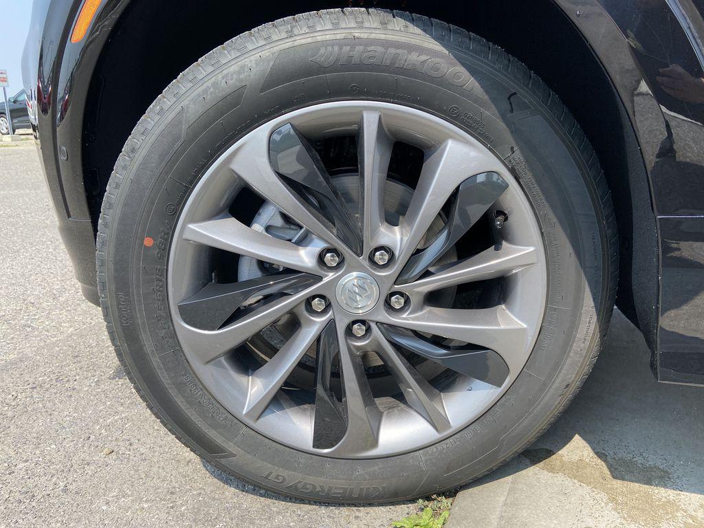 Black[Ebony Twilight Metallic] 2022 Buick Encore GX Essence Left Front Rim and Tire Photo in Calgary AB