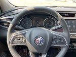 Black[Ebony Twilight Metallic] 2022 Buick Encore GX Essence Steering Wheel and Dash Photo in Calgary AB