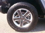 Silver[Billet Metallic] 2018 Jeep Wrangler Unlimited Left Front Rim and Tire Photo in Kelowna BC