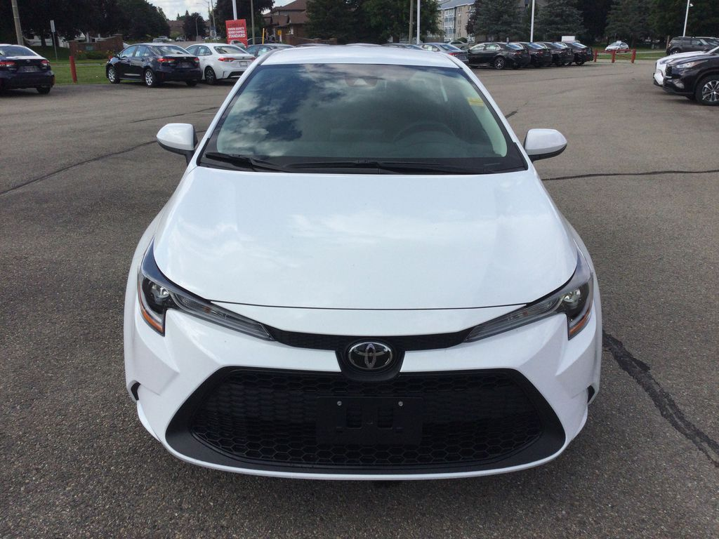 White[Blizzard Pearl] 2021 Toyota Corolla Front Vehicle Photo in Brockville ON
